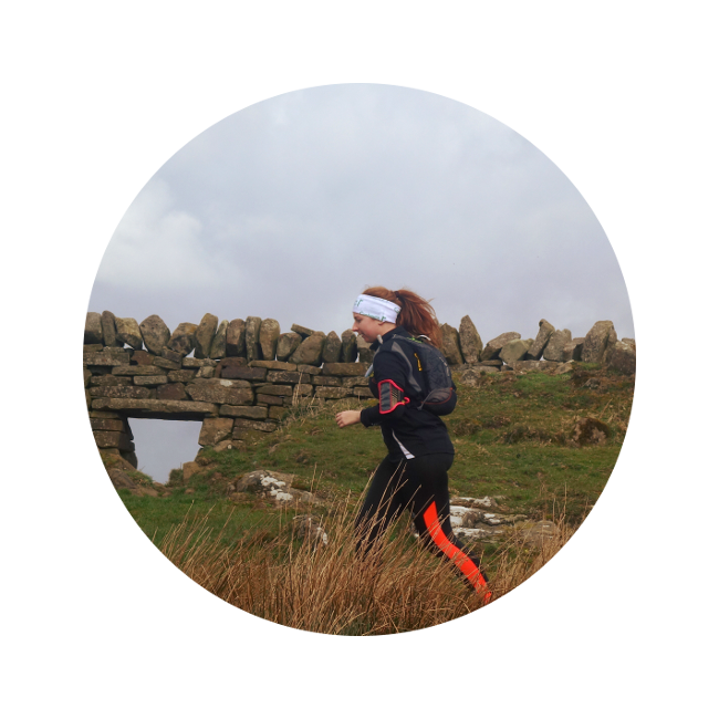 A runner on Hadrian's Wall Path with corporate discount