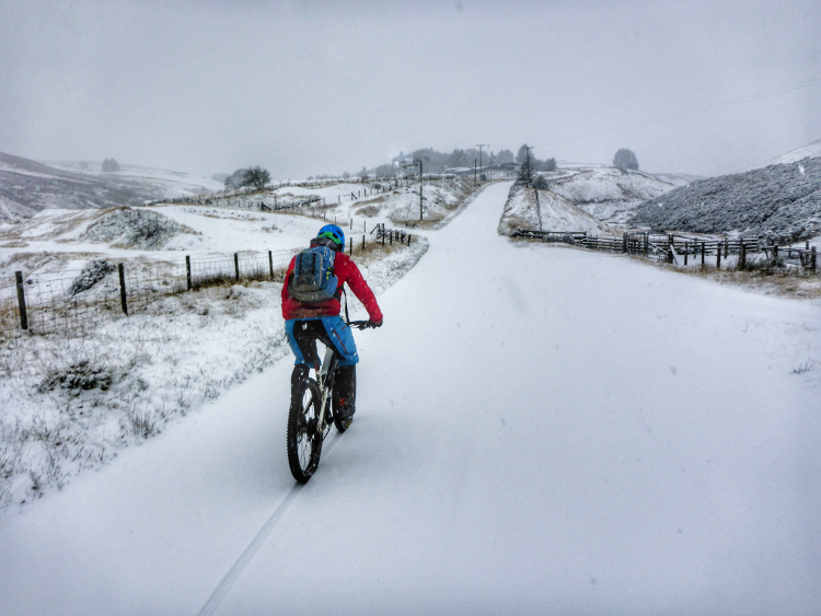 Mountain biking in the snow on the Trans Cambrian Way